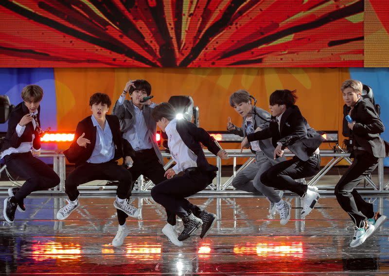 FILE PHOTO: Members of K-Pop band, BTS perform on ABC's 'Good Morning America' show in Central Park in New York