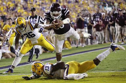 Dak Prescott (15) leaps into the end zone for a TD during the Mississippi State's 34-19 win over LSU. (AP)