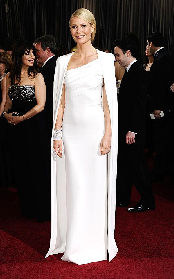 """Paltrow channeled Old Hollywood screen queen Grace Kelly when she wore a white cape dress by Tom Ford at the 2012 Oscars in February. The """"Avengers"""" actress wasn't nominated for an award this year, but she still managed to stun as a presenter. (2/26/2012)"""