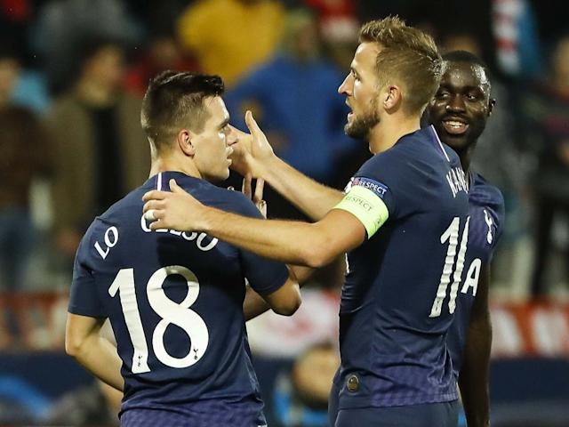 Giovani Lo Celso is embraced by Harry Kane after scoring for Spurs: Getty