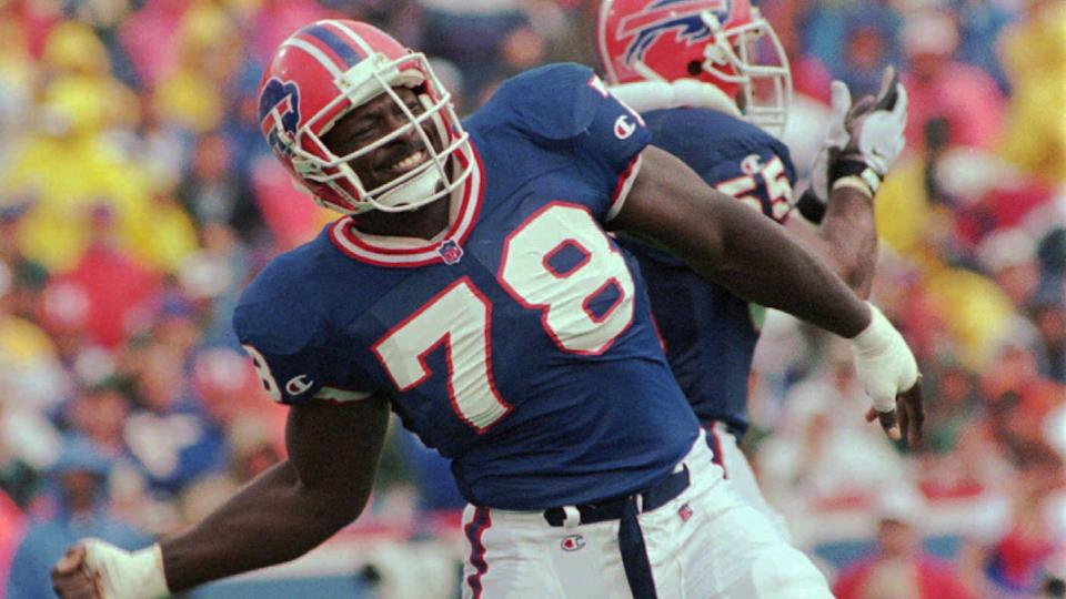 Mandatory Credit: Photo by Kevin Higley/AP/Shutterstock (6508999a)SMITH MADDOX Buffalo Bills defensive end Bruce Smith (78) celebrates a sack of New England Patriots quarterback Drew Bledsoe as Bills linebacker Mark Maddox, rear, applauds, during the third quarter of their game, at Rich Stadium in Orchard Park, N.