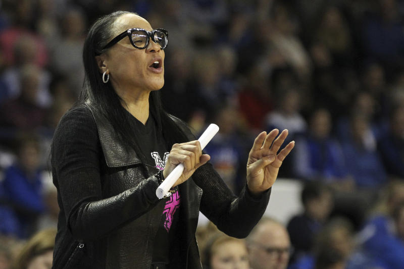 South Carolina head coach Dawn Staley directs her team during the second half of an NCAA college basketball game against Kentucky in Lexington, Ky., Sunday, Feb. 23, 2020. (AP Photo/James Crisp)