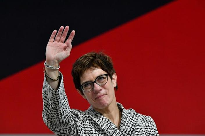 Merkel's onetime protegee in the end found it impossible to operate as the CDU's nominal leader when her mentor still held the chancellorship (AFP Photo/John MACDOUGALL)
