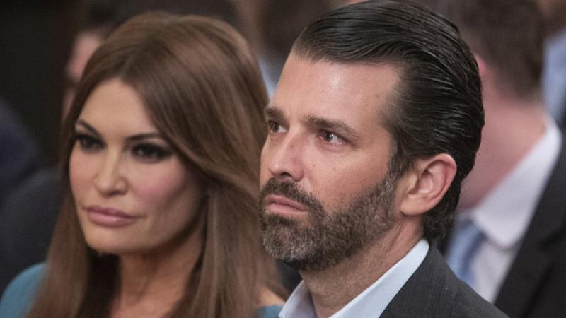 Donald Trump Jr and his girlfriend, Kimberly Guilfoyle, sitting next to each other