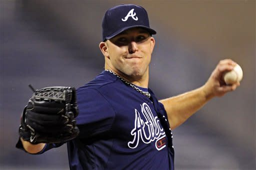 Atlanta Braves pitcher Paul Maholm delivers in the first inning of a baseball game against the Pittsburgh Pirates in Pittsburgh, Monday, Oct. 1, 2012. (AP Photo/Gene J. Puskar)