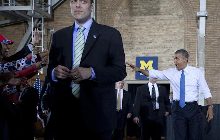 President Barack Obama waves as he arrives to speak at the University of Michigan, Wednesday, April 2, 2014, in Ann Arbor, Mich., about his proposal to raise the national minimum wage. (AP Photo/Carolyn Kaster)