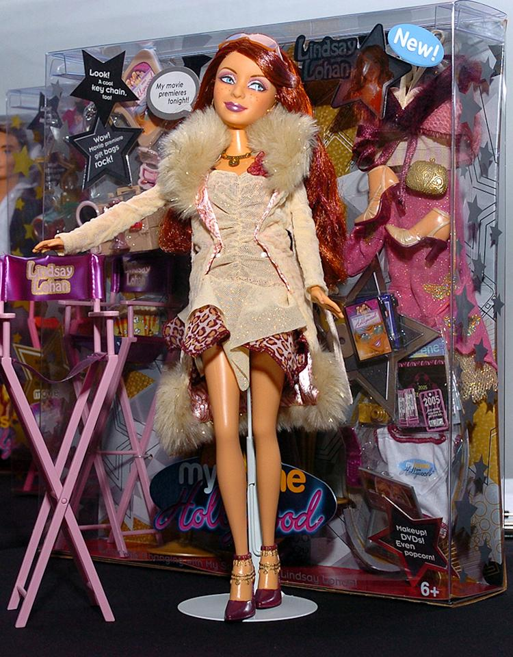"<b>HIGH: Mattel Makes Lindsay Into a Doll </b><br>If you didn't already realize Lohan was a star, it became crystal clear when Mattel made her into a special-edition doll for their ""My Scene Goes Hollywood"" collection in 2003! Dressed in a beige mini and fur-trimmed coat, the redheaded LiLo doll came complete with a director's chair and her very own velvet rope.<br>"