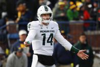 Michigan State quarterback Brian Lewerke (14) looks to the sidelines in the second half of an NCAA college football game against Michigan in Ann Arbor, Mich., Saturday, Nov. 16, 2019. (AP Photo/Paul Sancya)
