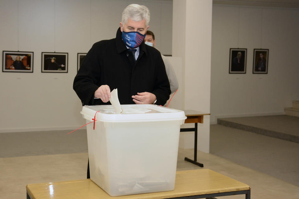 Dragan Covic of the Croatian Democratic Union (HDZ) casts his ballot for the local elections at a polling station in Mostar, Bosnia, Sunday, Dec. 20, 2020. Divided between Muslim Bosniaks and Catholic Croats, who fought fiercely for control over the city during the 1990s conflict, Mostar has not held a local poll since 2008, when Bosnia's constitutional court declared its election rules to be discriminatory and ordered that they be changed. (AP Photo)