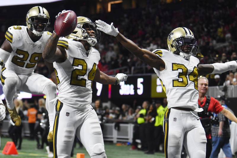 New Orleans Saints strong safety Vonn Bell (24) celebrates with teammates after his interception against the Atlanta Falcons during the second half of an NFL football game, Thursday, Nov. 28, 2019, in Atlanta. (AP Photo/John Amis)