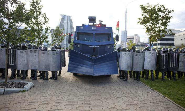 Riot police with a water cannon, block Belarusian opposition supporters during a rally protesting the official presidential election results in Minsk, Belarus, Sunday, Sept. 13, 2020. More than 100,000 demonstrators calling for the authoritarian president's resignation marched in the Belarusian capital on Sunday as the daily protests that have gripped the nation entered their sixth week. (TUT.by via AP)