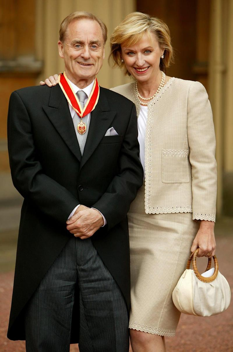 Sir Harold Evans at Buckingham Palace in London with his wife, Tina Brown, after he was knighted by the Prince of Wales for service to journalism(PA)