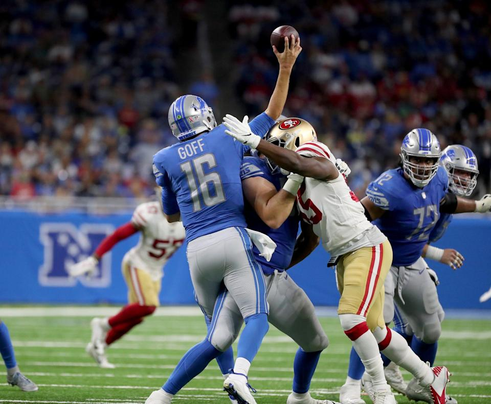 Detroit Lions quarterback Jared Goff is hit by San Francisco 49ers linebacker Dee Ford causing him to throw an interception returned for a touchdown Sunday, September 12, 2021 at Ford Field.