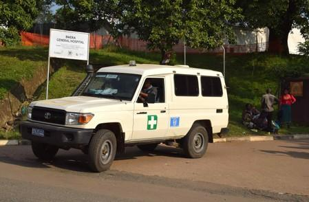 An ambulance drives from the Bwera general hospital near the border with the Democratic Republic of Congo in Bwera