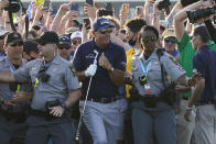 Phil Mickelson makes his way through fans on the 18th fairway during the final round at the PGA Championship golf tournament on the Ocean Course, Sunday, May 23, 2021, in Kiawah Island, S.C. (AP Photo/Matt York)