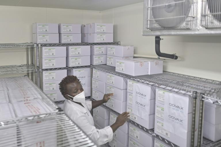 Medical personnel at the Nairobi National Vaccine Depot, where the country's first batch of COVID-19 vaccines are preserved in cold storage