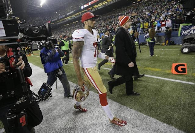 San Francisco 49ers' Colin Kaepernick walks off the field after the NFL football NFC Championship game against the Seattle Seahawks Sunday, Jan. 19, 2014, in Seattle. The Seahawks won 23-17 to advance to Super Bowl XLVIII. (AP Photo/Marcio Jose Sanchez)