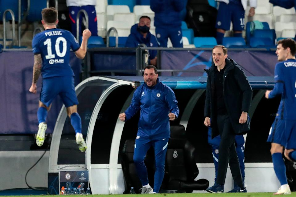 Chelsea's head coach Thomas Tuchel, second from right, reacts as Chelsea's Christian Pulisic, left, celebrates after scoring the opening goal during the Champions League semifinal first leg match against Real Madrid.