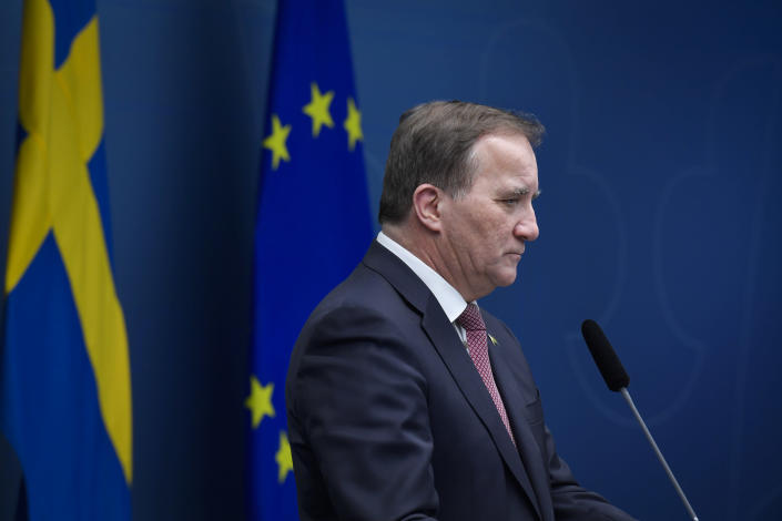 Sweden's Prime Minister Stefan Lofven pauses, during a coronavirus news conference, in Stockholm, Friday, Dec. 18,2020. The Swedish government is tightening nationwide coronavirus restrictions by lowering the number of people who can gather in a restaurant and making face masks mandatory on public transportation. Sweden has stood out among European nations for its comparatively hands-off response to the pandemic. (Jessica Gow/TT News Agency via AP)