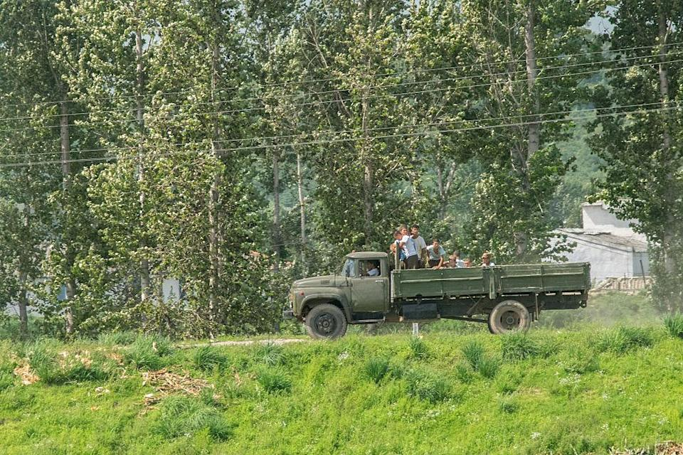 <p>Very few people in North Korea are able to drive. Cars and trucks are usually restricted to the Korean People's Army, and even trucks used for school children are usually just recycled rubbish cars. (Getty) </p>