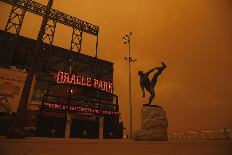 The San Francisco Giants and Oakland Athletics played their respective home games Wednesday night under an ominous orange sky caused by wildfires burning across Northern California. (Photo by Lachlan Cunningham/Getty Images)