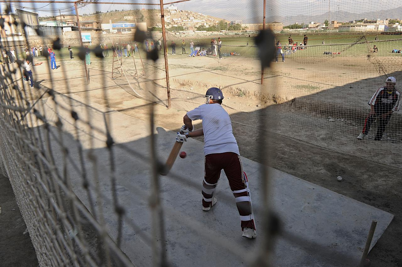 To go with Afghanistan-Cricket-Twenty20 by Phil Hazlewood  An Afghan cricketer bats in the nets during a practice session in Kabul on April 18, 2010. Afghanistan's debut in cricket's Twenty20 World Cup in the West Indies is the war-torn country's biggest achievement yet in its short, but remarkable, history in the international game. But whether they win or lose, their mere presence in the sport's short-format showpiece has a significance far beyond the boundaries of St Lucia's Beaysejour Stadium, where they face former champions India on May 1. AFP PHOTO/SHAH Marai (Photo credit should read SHAH MARAI/AFP/Getty Images)