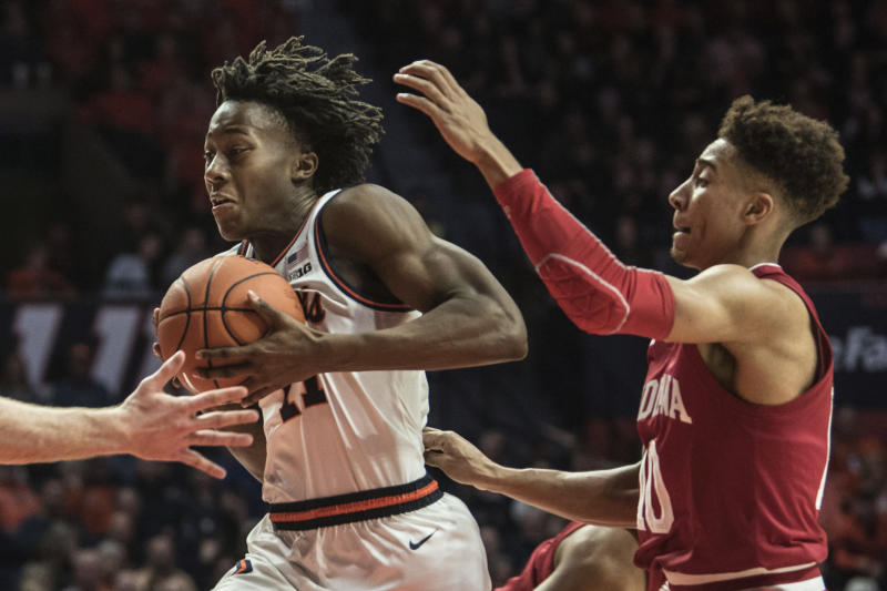 Illinois' Ayo Dosunmu (11) powers to the basket as Indiana's Rob Phinisee (10) defends in the first half of an NCAA college basketball game Sunday, March 1, 2020, in Champaign, Ill. (AP Photo/Holly Hart)