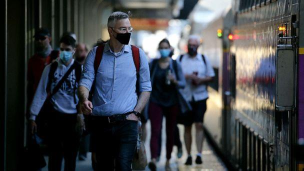 PHOTO: Commuters arrive at South Station in Boston, MA on July 14, 2020. (Craig F. Walker/The Boston Globe via Getty Images)