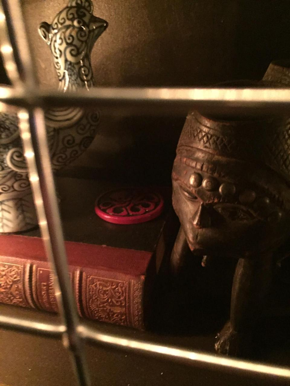 <p>Another knickknack packed into the cluttered bookcases in the study is this Hydra medallion. (Photo: Marcus Errico/Yahoo Movies) </p>