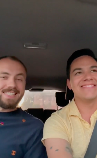they are smiling in the car