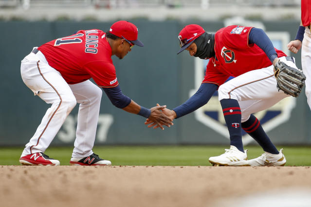 Minnesota Twins' Jorge Polanco, left, and Byron Buxton, right, celebrate their victory over the Cleveland Indians in a baseball game Sunday, March 31, 2019, in Minneapolis. (AP Photo/Bruce Kluckhohn)