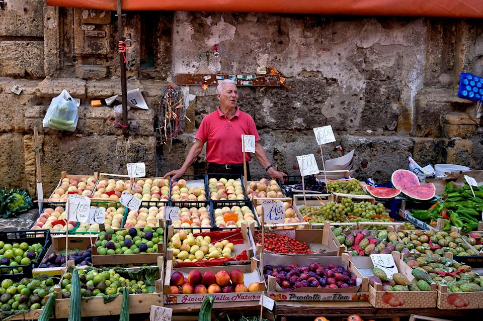 A fruit and vegetable stall at the Mercato Ballaro in Palermo.