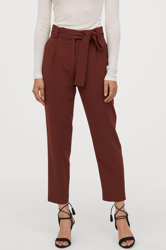 "<p>We're all about the color of these <a href=""https://www.popsugar.com/buy/HampM-Ankle-length-Slacks-494163?p_name=H%26amp%3BM%20Ankle-length%20Slacks&retailer=www2.hm.com&pid=494163&price=35&evar1=fab%3Aus&evar9=46676606&evar98=https%3A%2F%2Fwww.popsugar.com%2Ffashion%2Fphoto-gallery%2F46676606%2Fimage%2F46677605%2FHM-Ankle-length-Slacks&list1=shopping%2Cfall%2Cpants%2Cfall%20shopping%2Ccomfortable%20clothes&prop13=api&pdata=1"" rel=""nofollow"" data-shoppable-link=""1"" target=""_blank"" class=""ga-track"" data-ga-category=""Related"" data-ga-label=""https://www2.hm.com/en_us/productpage.0749615002.html"" data-ga-action=""In-Line Links"">H&amp;M Ankle-length Slacks</a> ($35).</p>"