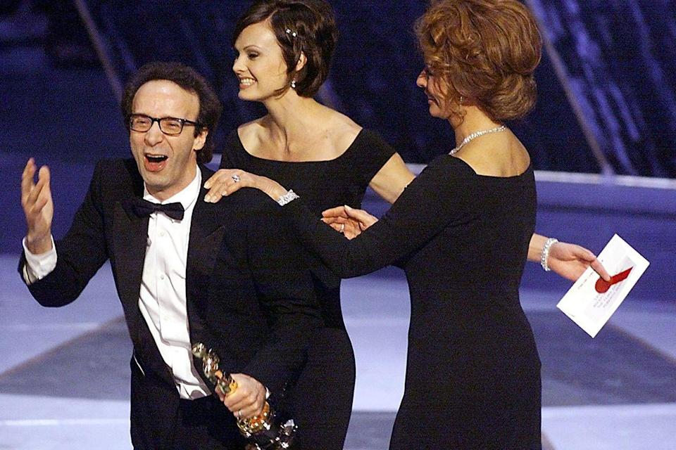"<p>Roberto Benigni was the life of the party and the man of the hour for his work in <em><a href=""https://www.amazon.com/dp/B00B3EJ0OY?ref=sr_1_1_acs_kn_imdb_pa_dp&qid=1547580289&sr=1-1-acs&autoplay=0&tag=syn-yahoo-20&ascsubtag=%5Bartid%7C10055.g.5132%5Bsrc%7Cyahoo-us"" rel=""nofollow noopener"" target=""_blank"" data-ylk=""slk:Life is Beautiful"" class=""link rapid-noclick-resp"">Life is Beautiful</a></em>, which won three awards.</p>"