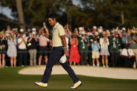 Hideki Matsuyama, of Japan, waves after winning the Masters golf tournament on Sunday, April 11, 2021, in Augusta, Ga. (AP Photo/Matt Slocum)
