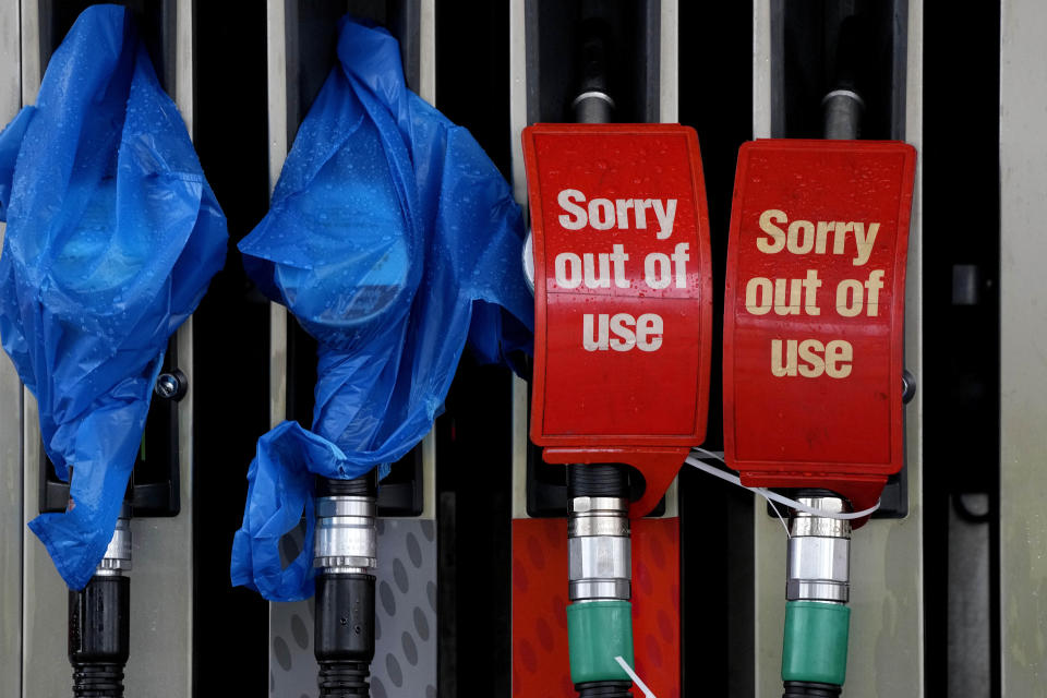 Fuel pumps are marked out of use at a petrol station in London, Thursday, Sept. 30, 2021. Many gas stations around Britain have shut down in the past five days after running out of fuel, a situation exacerbated by panic buying among some motorists. Long lines of vehicles formed at pumps that were still open, blocking roads and causing traffic chaos. Some drivers have had to endure hourslong waits to fill up. (AP Photo/Frank Augstein)