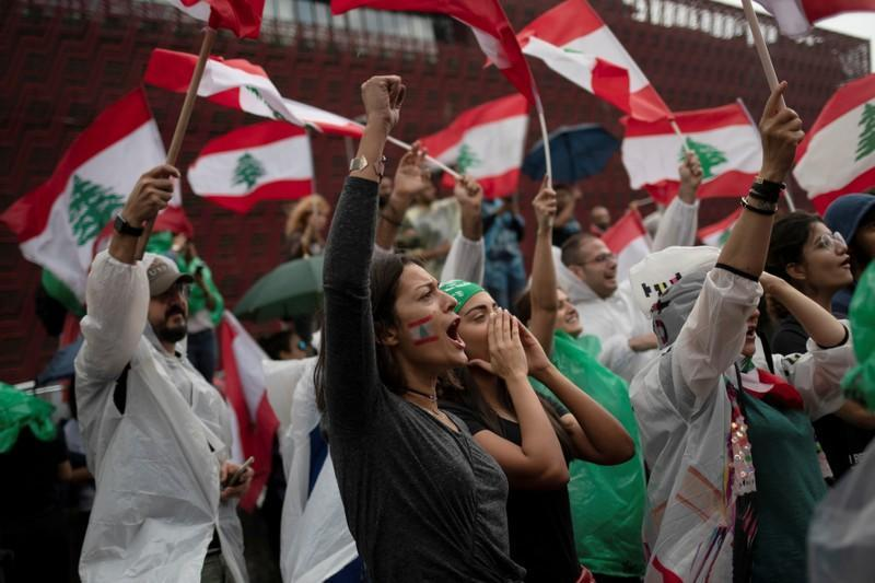 Demonstrators shout slogans during ongoing anti-government protests at a highway in Jal el-Dib