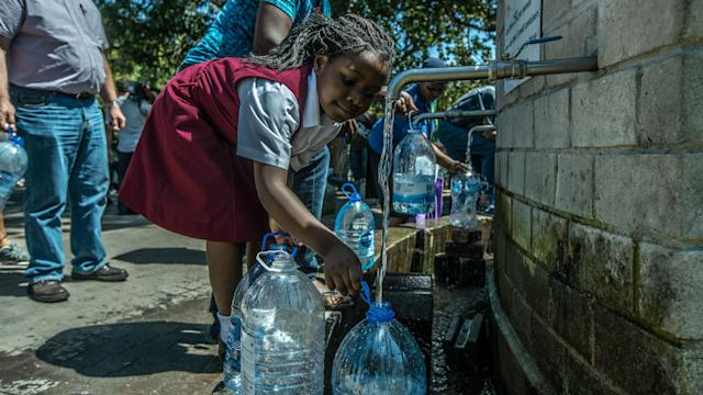 Cape Town residents queue to refill water bottles on Jan. 30, 2018. Diminishing water supplies may soon lead to the taps being turned off for the four million inhabitants of Cape Town.