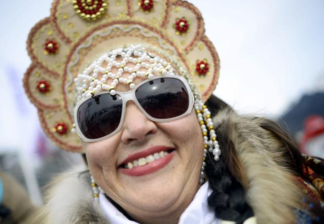 """A fan wearing a traditional Russian headdress called a """"kokoshnik"""", is seen in the stands during the women's snowboard slopestyle competition at the 2014 Sochi Olympic Games in Rosa Khutor February 9, 2014. REUTERS/Dylan Martinez (RUSSIA - Tags: SPORT OLYMPICS SNOWBOARDING TPX IMAGES OF THE DAY) ATTENTION EDITORS: PICTURE 25 OF 25 FOR PACKAGE 'SOCHI - EDITOR'S CHOICE' TO FIND ALL IMAGES SEARCH 'EDITOR'S CHOICE - 09 FEBRUARY 2014'"""