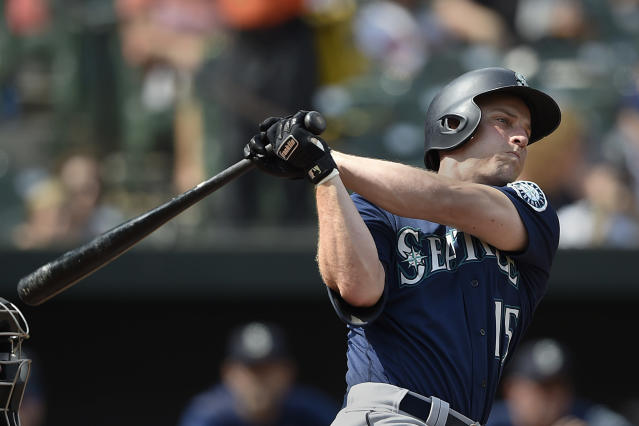 Seattle Mariners Kyle Seager follows through with an RBI double against the Baltimore Orioles in the first inning of a baseball game, Sunday, Sept. 22, 2019, in Baltimore. (AP Photo/Gail Burton)