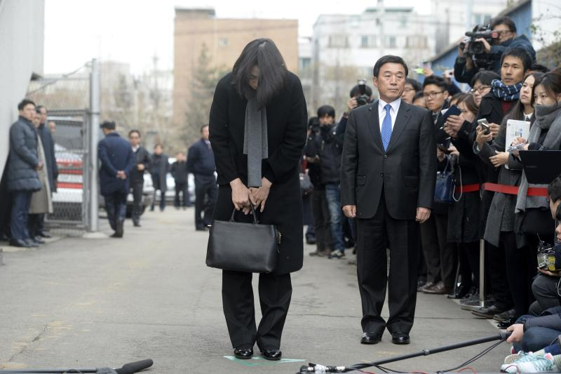 Cho Hyun-ah, also known as Heather Cho, daughter of chairman of Korean Air Lines, Cho Yang-ho, bows in front of the media outside the offices of the Aviation and Railway Accident Investigation Board of the Ministry of Land, Infrastructure, Transport, in Seoul December 12, 2014. Cho, 40, who was an executive at South Korea's flag carrier in charge of in-flight service until she quit this week, was being removed from all posts at affiliate companies. On December 19, while at New York's John F. Kennedy airport, seated in first class on a South Korea-bound flight, she was displeased with being served macadamia nuts in a bag and not a dish. The pilot brought the plane back to its gate for the cabin crew chief to be expelled.  REUTERS/Song Eun-seok/News1 (SOUTH KOREA