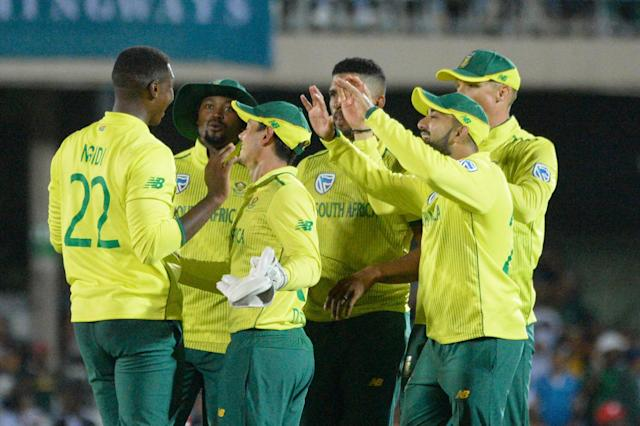 South Africa's Lungi Ngidi celebrates with teammates after catching out England's Jason Roy: AFP via Getty Images