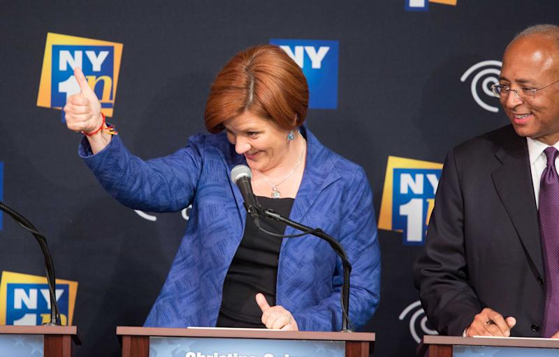 Christine Quinn gives a thumbs up, as rival Bill Thompson watches, as the Democratic candidates for Mayor of New York City face off for the first debate at the Town Hall Wednesday, August 21, 2013, in New York. (AP Photo/New York Times, Ruth Fremson, Pool)
