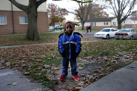 Ed Brown Jr., 2, who has lead poisoning poses for a portrait outside his home in South Bend, Indiana, November 29, 2016. REUTERS/Joshua Lott