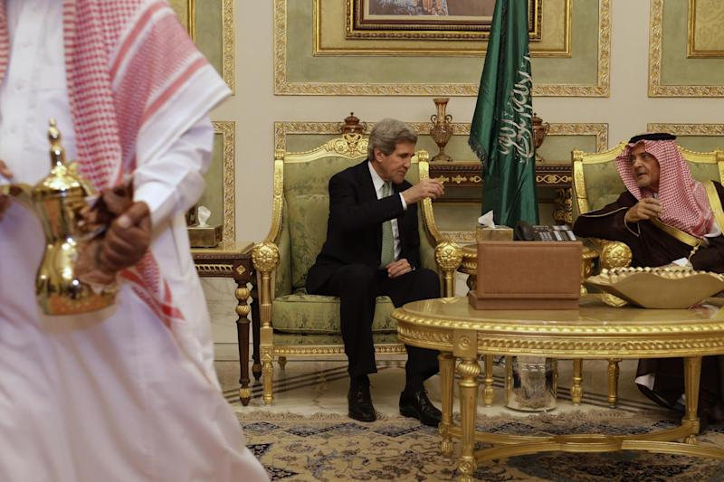 U.S. Secretary of State John Kerry drinks coffee with Saudi Foreign Minister Prince Saud al-Faisal, during a welcoming ceremony on his arrival in Riyadh, Saudi Arabia on Sunday, March 3, 2013. Saudi Arabia is the seventh leg of Kerry's first official overseas trip. (AP Photo/Jacquelyn Martin, Pool)