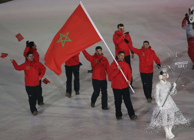 <p>Samir Azzimani carries the flag of Morocco during the opening ceremony of the 2018 Winter Olympics in Pyeongchang, South Korea, Friday, Feb. 9, 2018. (AP Photo/Michael Sohn) </p>