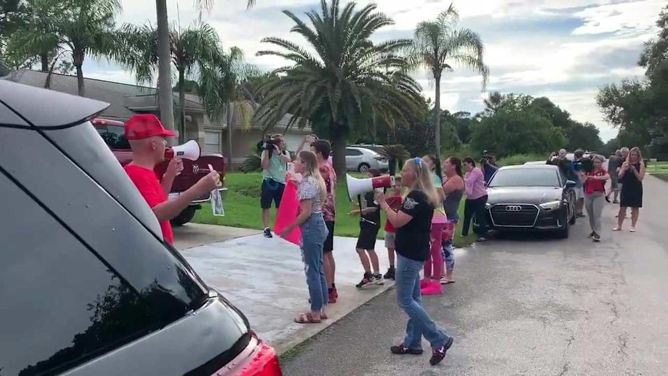 Protesters gather outside of the home of Brian Laundrie's parents in North Port, Florida, on September 20, 2021. Police served a search warrant at the home. / Credit: WINK
