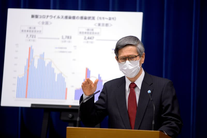 FILE PHOTO: President of the Japan Community Healthcare Organization Shigeru Omi addresses a news conference on the COVID-19 situation, in Tokyo