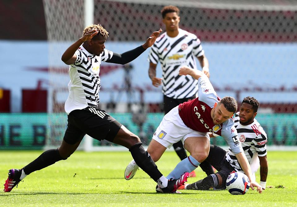Manchester United challenge John McGinn in midfield (Getty Images)