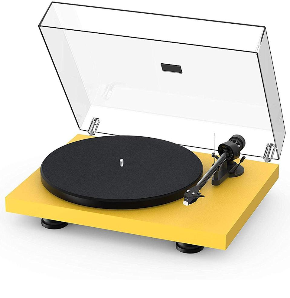 """<p><strong>Pro-Ject Audio Systems</strong></p><p>amazon.com</p><p><strong>$549.00</strong></p><p><a href=""""https://www.amazon.com/dp/B08FRLS96K?tag=syn-yahoo-20&ascsubtag=%5Bartid%7C10054.g.35269584%5Bsrc%7Cyahoo-us"""" rel=""""nofollow noopener"""" target=""""_blank"""" data-ylk=""""slk:Buy"""" class=""""link rapid-noclick-resp"""">Buy</a></p><p>Oh, you want to be fancy? </p><p>The final installment is for people who are getting into the particulars, upping the ante on how much they can play with sound and produce new music. Yes, this is a higher price point, even for one of the most popular tables on the market, but it also comes with more customizable components. With richer sound quality and additional components (like the removable braided Connect-It E RCA cables), the savings are practically baked into the price.</p><p>Keeping with the new standard, this turntable has a 2M Red moving magnet cartridge, which boasts """"open sound"""" with some warmth. Naturally, when you're on the far end of the price spectrum, you want to know that what you're buying is customizable: This one offers that in spades. Not only are you able to personalize its appearance, but once you have the table itself, many of its connections, as well as its inputs, can be switched out to suit your style.</p>"""